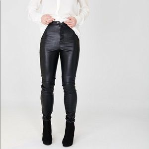 DIVIDED black leather pants.